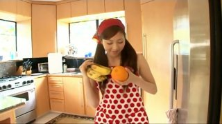 Young Japanese house wife Natsuko Tatsumi makes a fruit salad