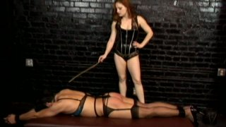Pale skin redhead mistress Gemini whips her bitch's juicy ass