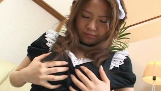 Playful Japanese maid Yuka Koizumi is getting her nipples squeezes hard