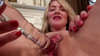 Busty American mature toying herself