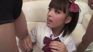Cute girl Rin Yuzuki blows two hairy cocks and licks small balls