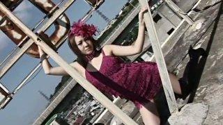 Glamorous dark haired Japanese babe poses on cam