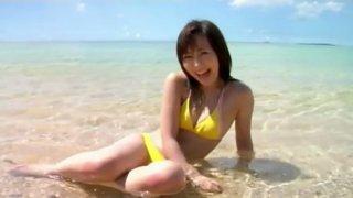 Pale skin Japanese babe Gratin poses on the beach