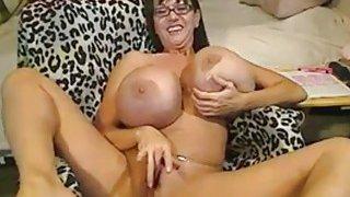 Mature with big silicone tits masturbates on webcam